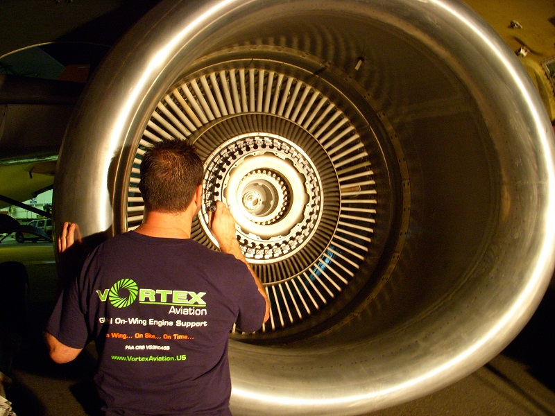 Man working on aviation engine